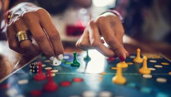 Adults playing a board game