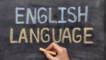 English Language written on a chalkboard