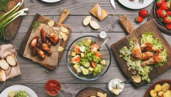 Barbecue meal laid out on wood table