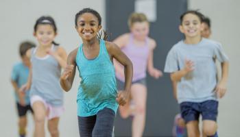 Children running in a gym