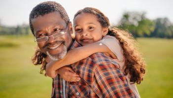 Older man with his granddaughter