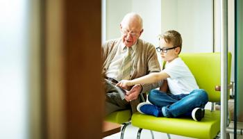 Grandfather and child reading